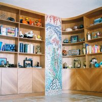 <P>clear lacquer on cherry serpentine shaped bookcases</P>