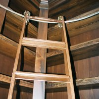 Old world style built in custom library is made of solid cypress wood. The Putnam rolling ladder is oak.